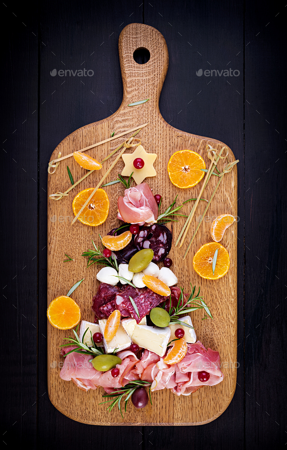 Antipasto platter with ham, prosciutto, salami, cheese,  crackers and olives - Stock Photo - Images