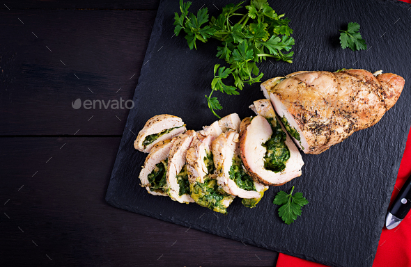 Roasted sliced Christmas roll of turkey with spinach and cheese - Stock Photo - Images