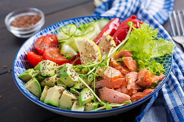 Healthy grilled salmon, avocado, tomato, cucumber, paprika and chia seeds. - Stock Photo - Images