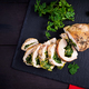 Roasted sliced Christmas roll of turkey with spinach and cheese - PhotoDune Item for Sale