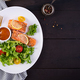 Baked salmon fillet with fresh vegetables salad. - PhotoDune Item for Sale