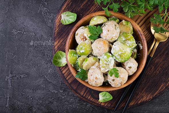 Brussels sprouts roasted with chicken meatballs and onions in a creamy sauce. Top view - Stock Photo - Images