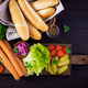 Ingredients for hot dog with  sausage, pickled cucumber, tomatoes, red onions and lettuce - PhotoDune Item for Sale