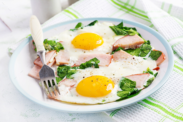 Fried eggs  with ham and spinach. Delicious English Breakfast. Brunch. Keto/paleo diet. - Stock Photo - Images