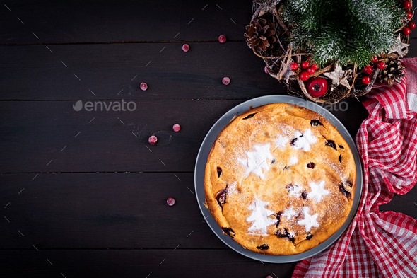 Christmas fruit cake, pudding on dark table. Top view, overhead, copy space. - Stock Photo - Images