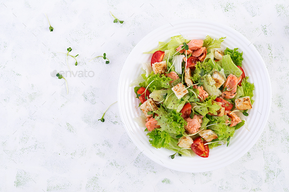 Caesar Salad with Salmon. Fish menu. Seafood - salmon. Top view, overhead, copy space - Stock Photo - Images