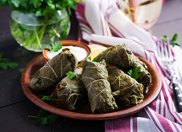Dolma. Stuffed grape leaves with rice and meat on dark table. Middle eastern cuisine. - Stock Photo - Images