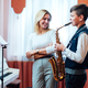 Cheerful teacher with student boy learning saxophone lessons at school - PhotoDune Item for Sale