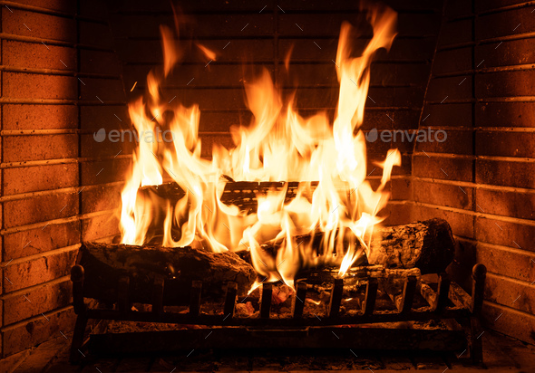 Burning fireplace, real wood logs, cozy warm home at xmas time - Stock Photo - Images