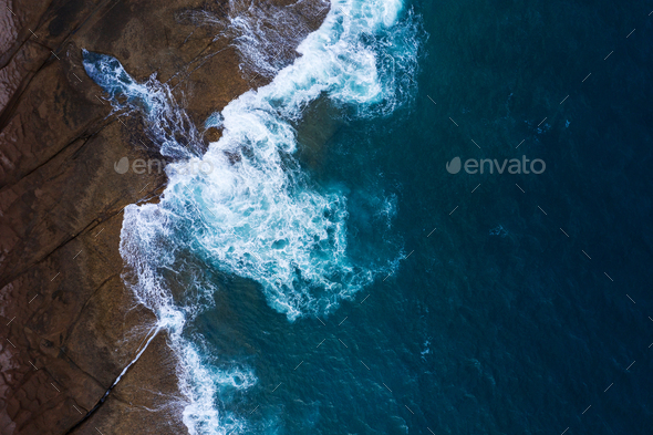 Rocky shore of the island of Tenerife. Aerial drone photo of ocean waves reaching shore - Stock Photo - Images