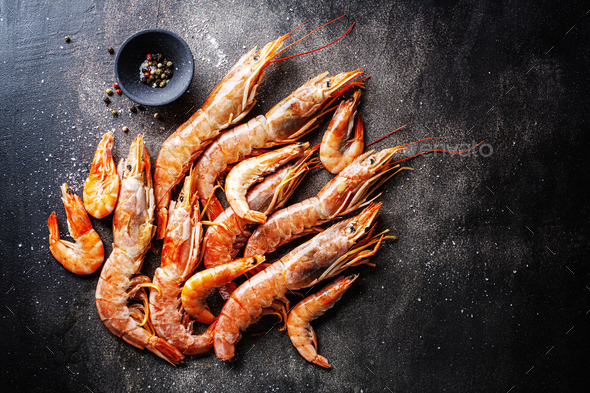Raw giant shrimps on dark table - Stock Photo - Images