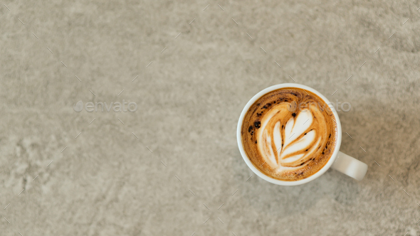 Heart shaped coffee latte stacked in white glass on a concrete floor. - Stock Photo - Images