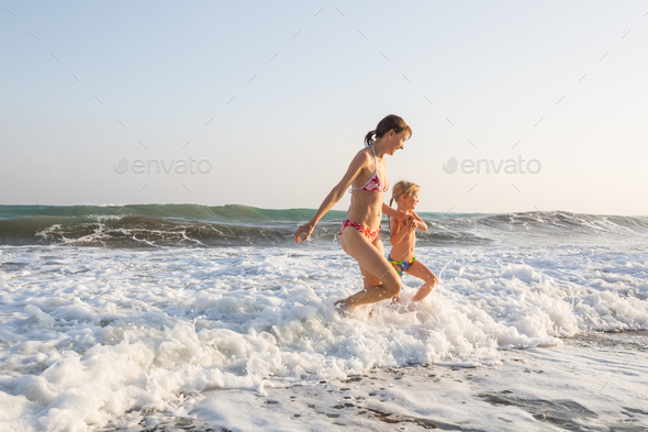 Family on the beach - Stock Photo - Images