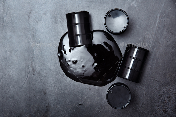 Containers with oil spilled at industrial site - Stock Photo - Images