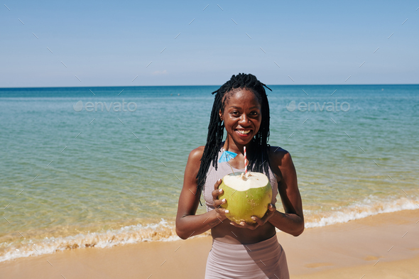 Young woman with big green coconut - Stock Photo - Images