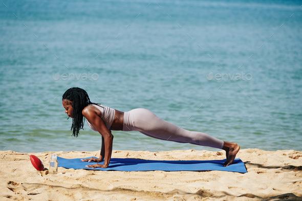 Sportswoman doing push-ups - Stock Photo - Images