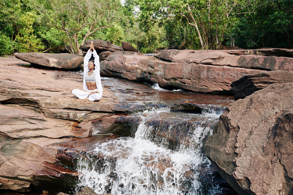 Woman meditating in nature - Stock Photo - Images