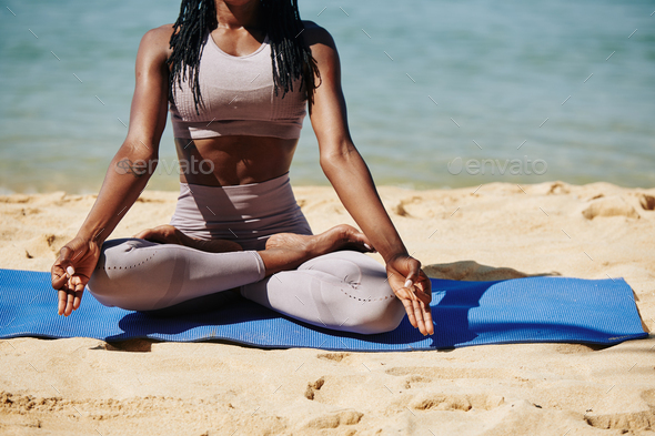 Meditating young woman - Stock Photo - Images