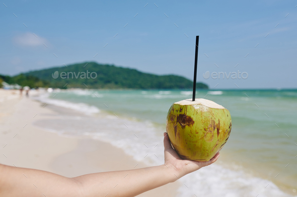 Green coconut with drinking straw - Stock Photo - Images