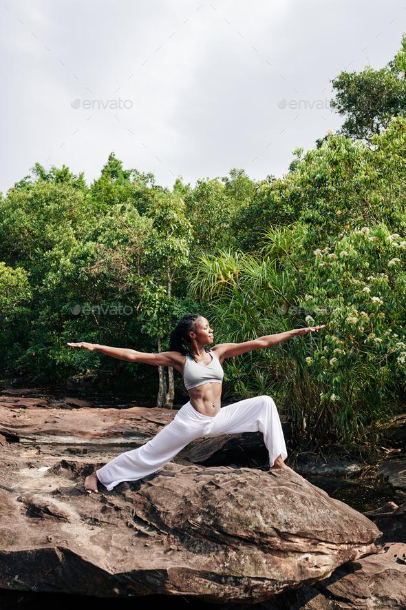 Woman enjoying yoga retreat - Stock Photo - Images