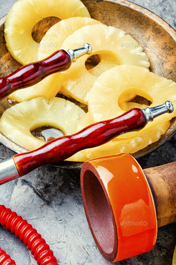 Pineapple flavored hookah. - Stock Photo - Images