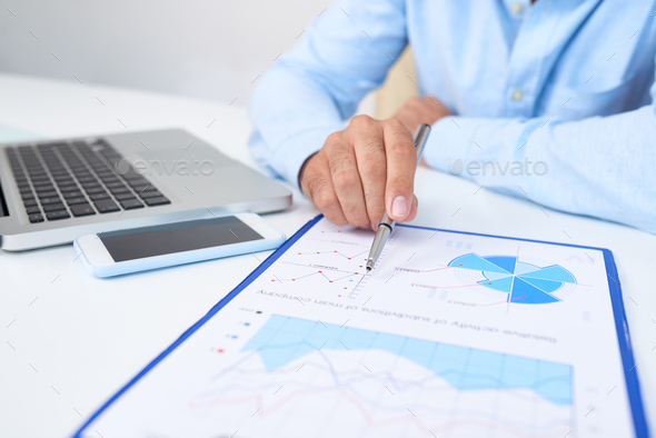 Financial manager analyzing report - Stock Photo - Images