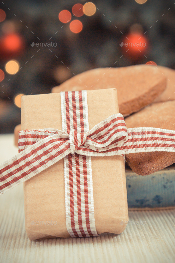 Wrapped gift, gingerbreads and christmas tree - Stock Photo - Images