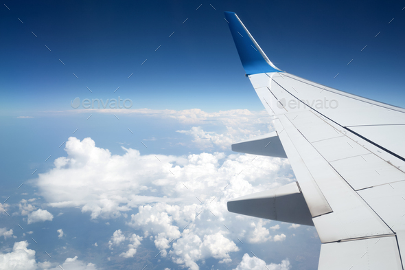The Wing of Airplain on Blue Sky. - Stock Photo - Images