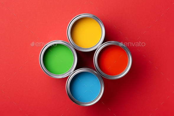 Four Cans of Colorful Paint on Red Background. - Stock Photo - Images