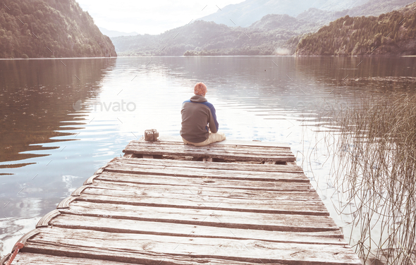 Man on the lake - Stock Photo - Images