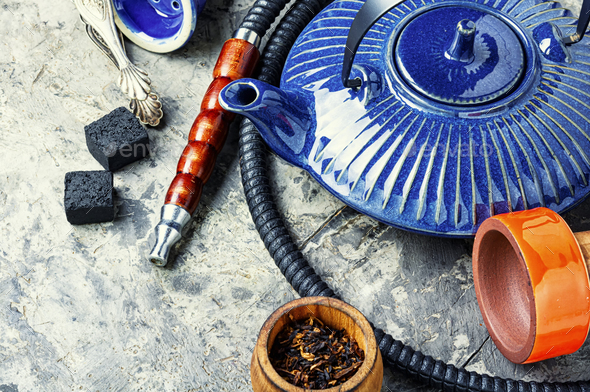 Oriental hookah with kettle - Stock Photo - Images