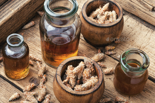 Bottles of tincture of pine buds - Stock Photo - Images
