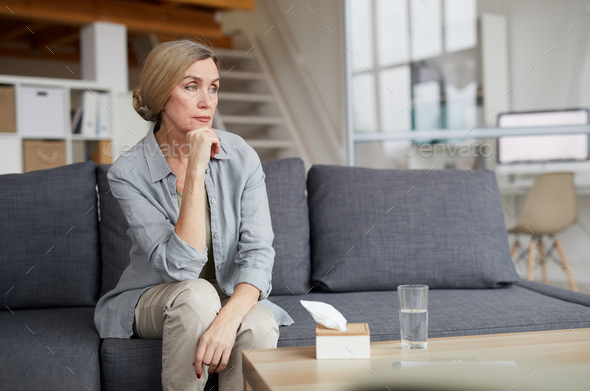 Pensive Mature Woman at Home - Stock Photo - Images