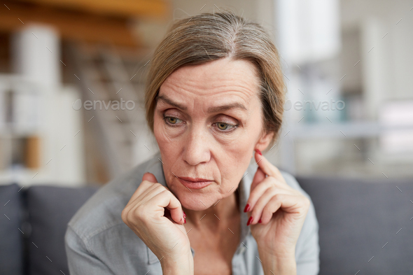 Portrait of Worried Mature Woman - Stock Photo - Images