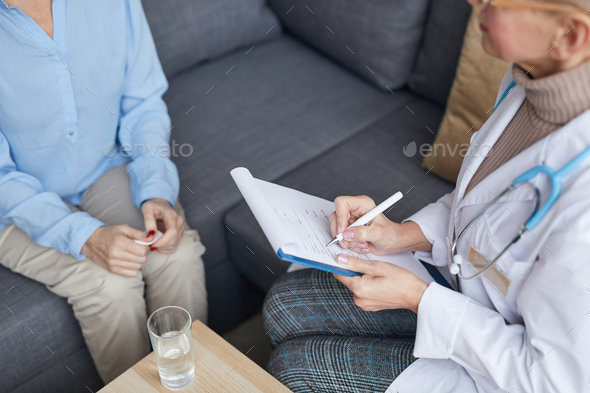 Female Doctor Writing on Clipboard Closeup - Stock Photo - Images