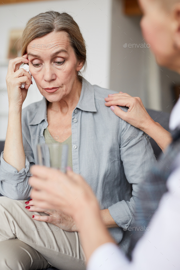 Crying Mature Woman in Therapy Session - Stock Photo - Images