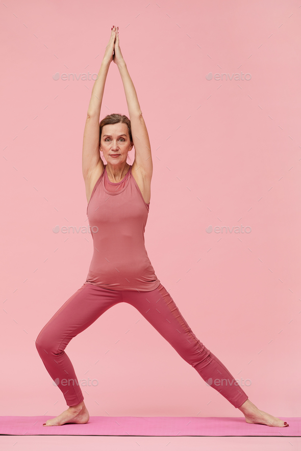 Mature Woman Doing Yoga on Pink - Stock Photo - Images