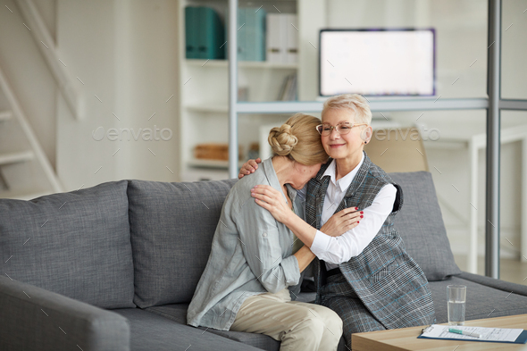 Female Psychologist Comforting Woman in Therapy Session - Stock Photo - Images