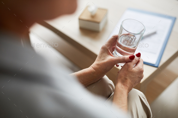 Therapy Patient Holding Glass of Water - Stock Photo - Images