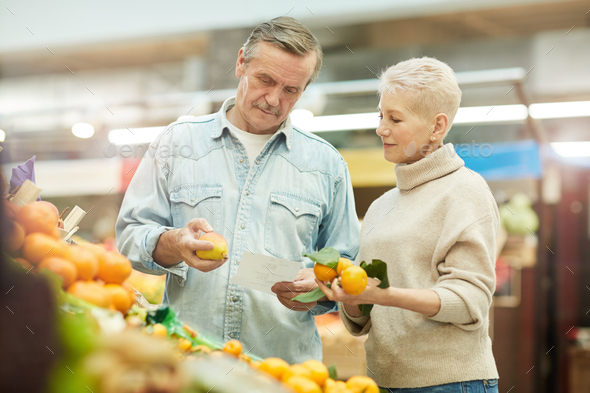 Senior Couple Choosing Fruits at Farmers Market - Stock Photo - Images