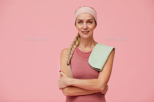 Sportive Adult Woman Posing against Pink - Stock Photo - Images