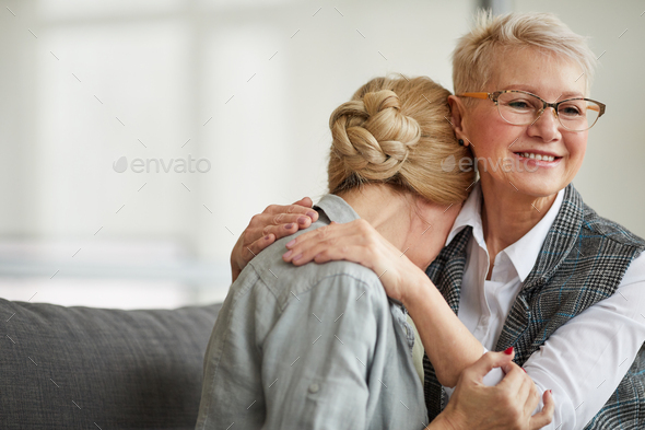 Smiling Female Psychologist Comforting Woman in Therapy Session - Stock Photo - Images
