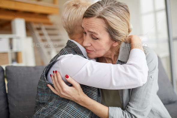 Grateful Patient Embracing Female Psychologist - Stock Photo - Images
