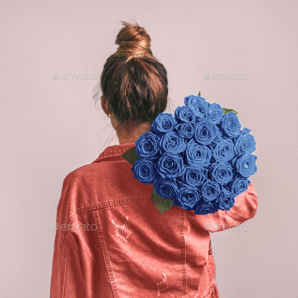 Back view of woman, holding Classic Blue roses - Stock Photo - Images