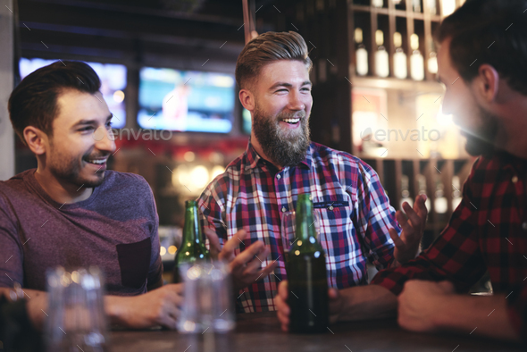 Happy man catches attention of his friend - Stock Photo - Images