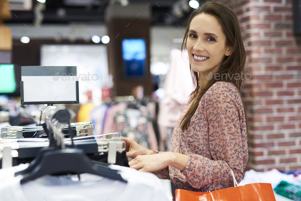 Portrait of smiling woman in the clothes shop - Stock Photo - Images