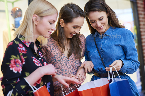 Happy woman showing what she bought - Stock Photo - Images