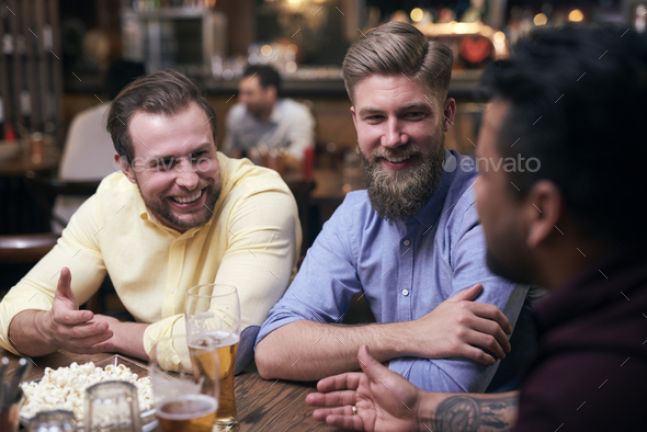 Men spending the weekend in the pub - Stock Photo - Images