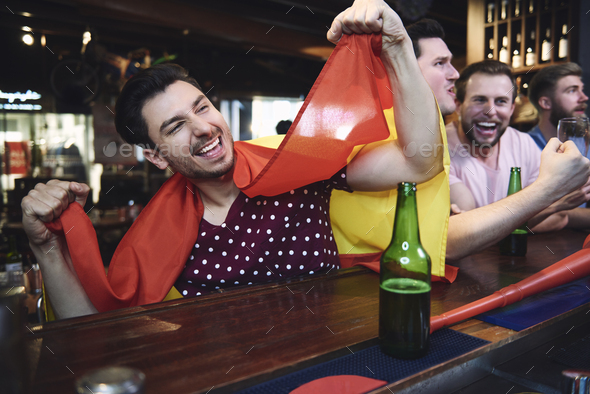 Soccer fan feel good about winning - Stock Photo - Images
