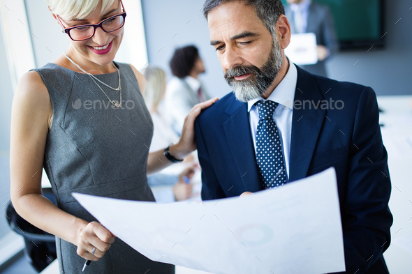 Successful team leader and business owner leading informal in-house business meeting - Stock Photo - Images